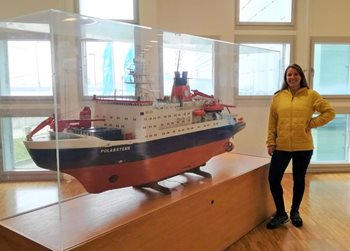 Maria Gomes at AWI in front of the model of the RV Polarstern